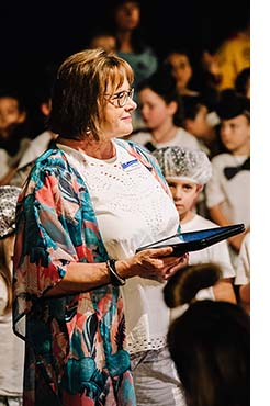 Mrs Skinner at the end of year school concert