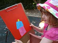 Little girl with artwork